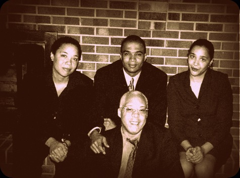 Adam and his siblings (left to right): Christina Dyan Cobb, Craig Delano Cobb and Clara Denise Cobb at Dozier's funeral.