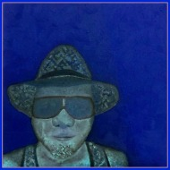 """Painting: Oil on Canvas. """"Portrait in Blues"""", 40 x 40 cm., oil on canvas, is a self-portrait mimicking Van Gogh's self-portrait series of himself wearing a straw hat -- but in a modern abstract expressionistic style in a symphony of blue tones."""